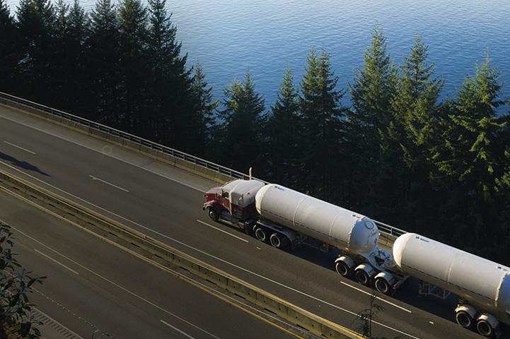 An image of a truck transporting materials on a highway.