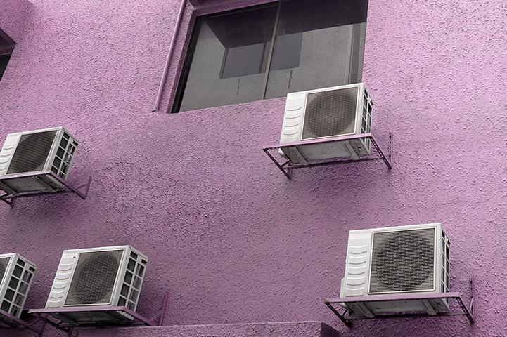 An image of air conditioners on the side of a building.