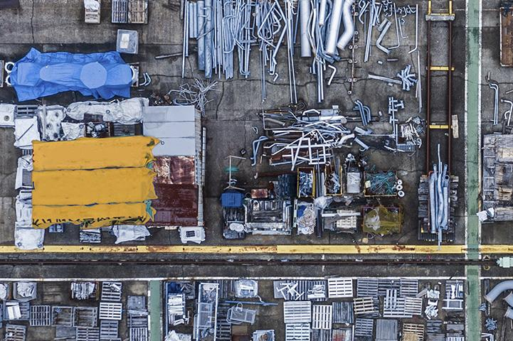An Aerial shot of industrial material waste at a warehouse.