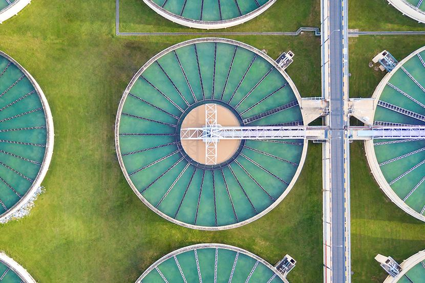 aerial view of round tanks at water treatment plant