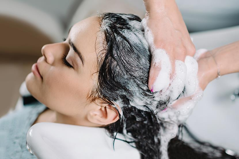 woman at salon getting hair washed