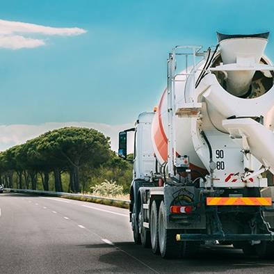cement mixer truck driving down the road