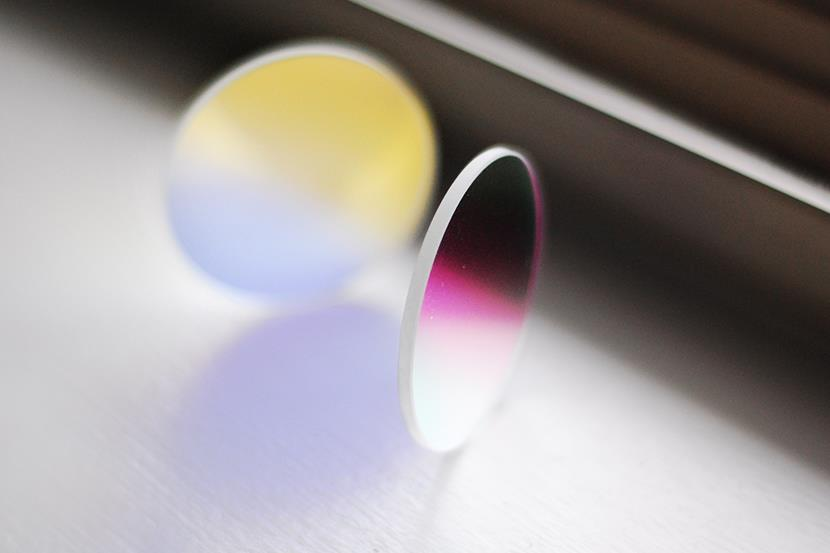 two round dichroic glass lenses